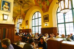 MUNICH, GERMANY - OCTOBER 14, 2017: Interior of main beer restaurant Hofbrauhaus. With tourists and football funs stock image