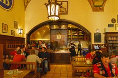 MUNICH, GERMANY - OCTOBER 14, 2017: Interior of main beer restaurant Hofbrauhaus. With tourists and football funs royalty free stock photography