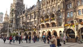 Munich Marienplatz square with tourists and local german people visiting in Munchen city centre old town, Germany stock video footage