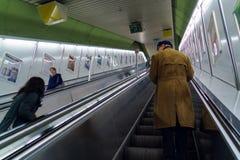 Subway passengers on escalator at the Ubahn station, Munich, Ger. Munich, Germany - October 25, 2017: Subway passengers on escalator at the Ubahn station Royalty Free Stock Photography