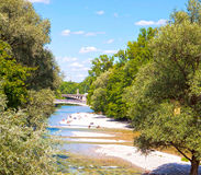 Munich Germany, people relax sun bathing along Isar river in cen Royalty Free Stock Photos