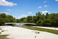 Munich Germany, people relax sun bathing on Isar river banks nea Royalty Free Stock Images
