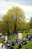 Munich, Germany - people sitting leisurely on the green outdoors Royalty Free Stock Photo
