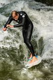 Surfing on the Eisbach River - Englischer Garten Munich royalty free stock photography