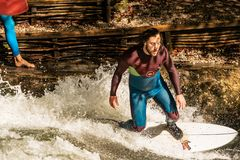Surfing on the Eisbach River - Englischer Garten Munich royalty free stock images