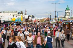 Munich, Germany-September 27,2017: Crowds of people at Oktoberfest on Munich`s Theresienwiese is the biggest beer festival.  stock photo