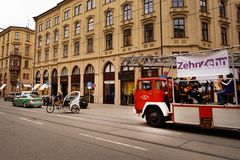 Munich, Germany, September 15, 2018: man on a bike and firefighters car in Munich royalty free stock photos