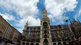 Marienplatz, Germany. View of the new Town Hall on a background of clouds and blue sky stock video