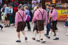 Munich, Germany-September 27, 2017: Men in traditional bavarian clothes leather pants walk on the Oktoberfest Royalty Free Stock Photography