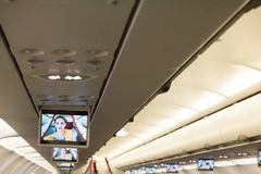 Airplane Safety demostration on screen. Royalty Free Stock Image