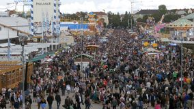 Top view of crowd on central street in Oktoberfest. Bavaria, Germany. MUNICH, GERMANY, SEPTEMBER 16, 2017: Top view of crowd on central street in Oktoberfest stock footage
