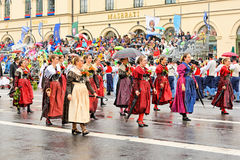 Munich, Germany, September 18, 2016: The Traditional Costume Parade during Octoberfest 2016 in Munich. German people wearing traditional costumes marching Stock Photos