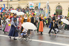 Munich, Germany, September 18, 2016: The Traditional Costume Parade during Octoberfest 2016 in Munich. German people wearing traditional costumes marching Royalty Free Stock Photos