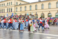 Munich, Germany, September 18, 2016: The Traditional Costume Parade during Octoberfest 2016 in Munich. German people wearing traditional costumes marching Stock Photo