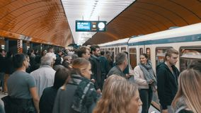 Underground metro in Munich. People getting out and into the train. MUNICH, GERMANY, SEPTEMBER 15, 2017: Underground metro in Munich. The train arrives at the stock video