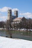 Munich (Germany) in winter. Sankt Maximilian church on Isar river bank in Munich in winter royalty free stock photos