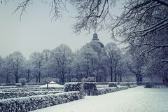Munich Hofgarten, winter view. Munich, Germany, winter view with snow of the Hofgarten baroque garden built in XVII century, withs the dome of Bavarian State royalty free stock photo