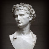 Bust of Roman Emperor August wearing the civ. Ic wreath (corona civica), the most valued honors among the Ancient Romans.Marble, Ca. 40—50 AD.The bust is Stock Images