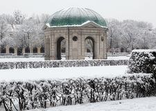 Munich, Hofgarten pavilion with snow. Munich, Germany, winter view with snow of the Hofgarten round pavilion in the baroque garden built in XVII century by royalty free stock photography
