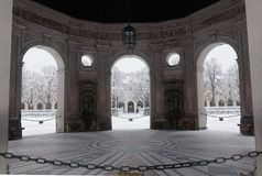 Munich, Hofgarten view from Renaissance pavilion. Munich, Germany, winter view with snow of the Hofgarten park from the round pavilion baroque porticoes built in stock image