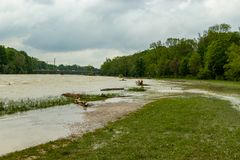 munich, isar, brudermuehlbruecke, Mai 22, 2019: storm deep axel is flooding the isar in munich royalty free stock image