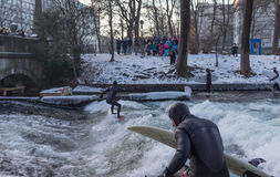 MUNICH – JANUARY 28: A surfer riding top of a wave on river Isar Royalty Free Stock Photos