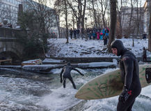 MUNICH – JANUARY 28: A surfer riding top of a wave on river Isar Stock Photos