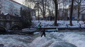MUNICH – JANUARY 28: A surfer riding top of a wave on river Isar Royalty Free Stock Image