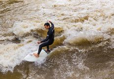 MUNICH-JUNE 14. Surfer man on the Eisbach in the English Garden in Munich on June 14, 2018 in Munich, Germany. This river flows through the Englischer Garden royalty free stock images