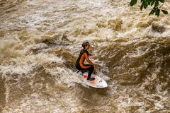 MUNICH-JUNE 14. Surfer man on the Eisbach in the English Garden in Munich on June 14, 2018 in Munich, Germany. Stock Photography