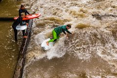 MUNICH-JUNE 14. Surfer man on the Eisbach in the English Garden in Munich on June 14, 2018 in Munich, Germany. Stock Image
