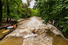 MUNICH-JUNE 14. Surfer man on the Eisbach in the English Garden in Munich on June 14, 2018 in Munich, Germany. Stock Images