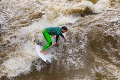 MUNICH-JUNE 14. Surfer man on the Eisbach in the English Garden in Munich on June 14, 2018 in Munich, Germany. Stock Photos