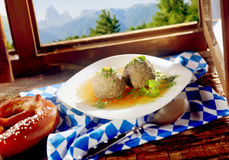 Munich Liver Dumplings with a savory sauce and fresh herbs Stock Photography