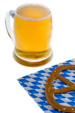 Munich October celebration with beer and cracknel. Against white background royalty free stock images