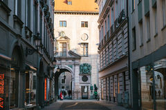 Munich, October 29, 2017: Perspective view of alley, narrow street intersection surrounded by modern and historical Stock Photography
