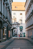 Munich, October 29, 2017: Perspective view of alley, narrow street intersection surrounded by modern and historical Royalty Free Stock Photo