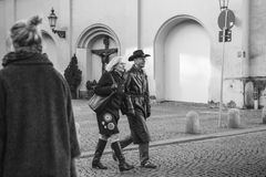 Munich, October 29, 2017: Stylish smiling elderly couple in love, walking and holding hands. Editorial black and white image of stylish smiling elderly couple in Royalty Free Stock Photography
