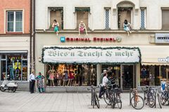 Munich original Steindl store. Munich, Germany - May 29, 2016: People in the street passing next to the Original Steindl store with traditional Bavarian clothing Royalty Free Stock Photography