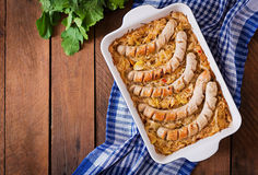 Munich sausages with fried cabbage. Royalty Free Stock Image