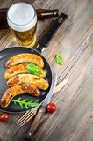 Munich sausages with tomatoes Royalty Free Stock Photography