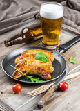 Munich sausages with tomatoes and arugula Stock Photography