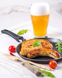 Munich sausages with tomatoes and arugula Royalty Free Stock Images