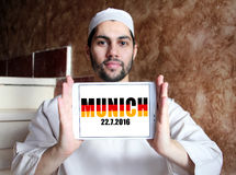 Munich terror attacks in germany. Munich terror attacks on 22 july 2016 in germany on white tablet holded by arab religious muslim man royalty free stock photo