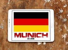 Munich terror attacks in germany. Munich terror attacks on 22 july 2016 in germany on white tablet on wooden background royalty free stock image
