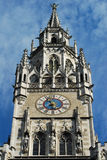 Munich Town Hall clock. Munich Town Hall was built between 1867 and 1908 by Georg von Hauberrisser in a Gothic Revival architectural style. It's main façade stock images