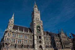 Munich town hall detail in the sun against blue sky Stock Photos