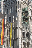 Munich Town Hall with Flags Stock Photo