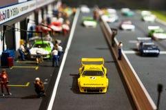 Munich Tyskland - mars 10, 2016: Liten modell av skärm för tävlings- spår i BMW museet Arkivbild