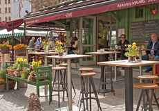 Munich, Viktualien markt, open air cafe. An open air café on spring time in Viktualian markt, a famous market in the center of the town, open every working day royalty free stock photos